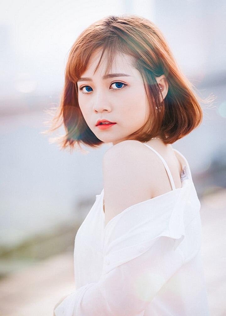 Hình ảnh girl xinh với cặp mắt bồ câu và mái tóc ngắn rất dễ thương và đáng yêu